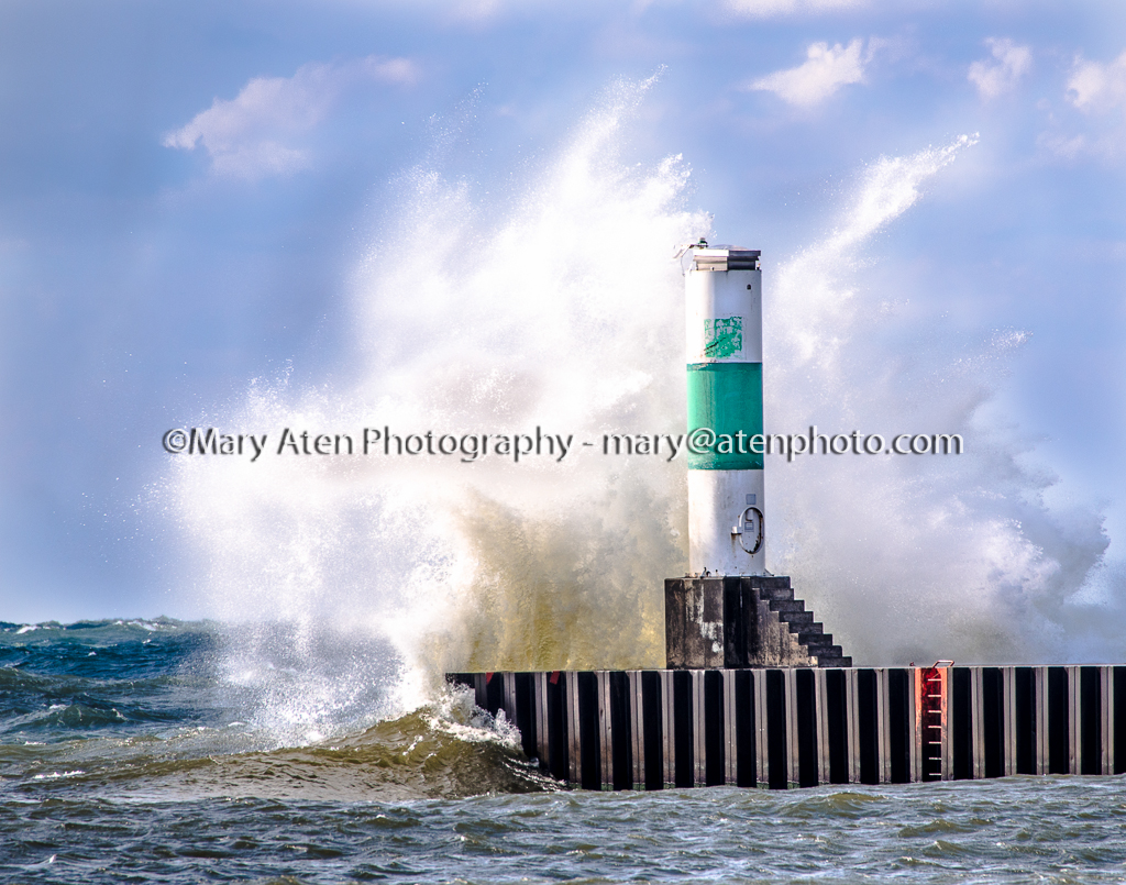 Photo Splash Against Lighthouse Mary Aten Photography