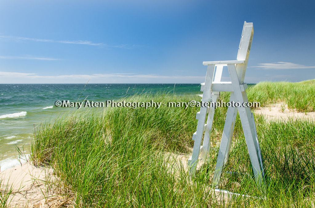 Life Guard Stand Photo With Beach Grass Sand Water And