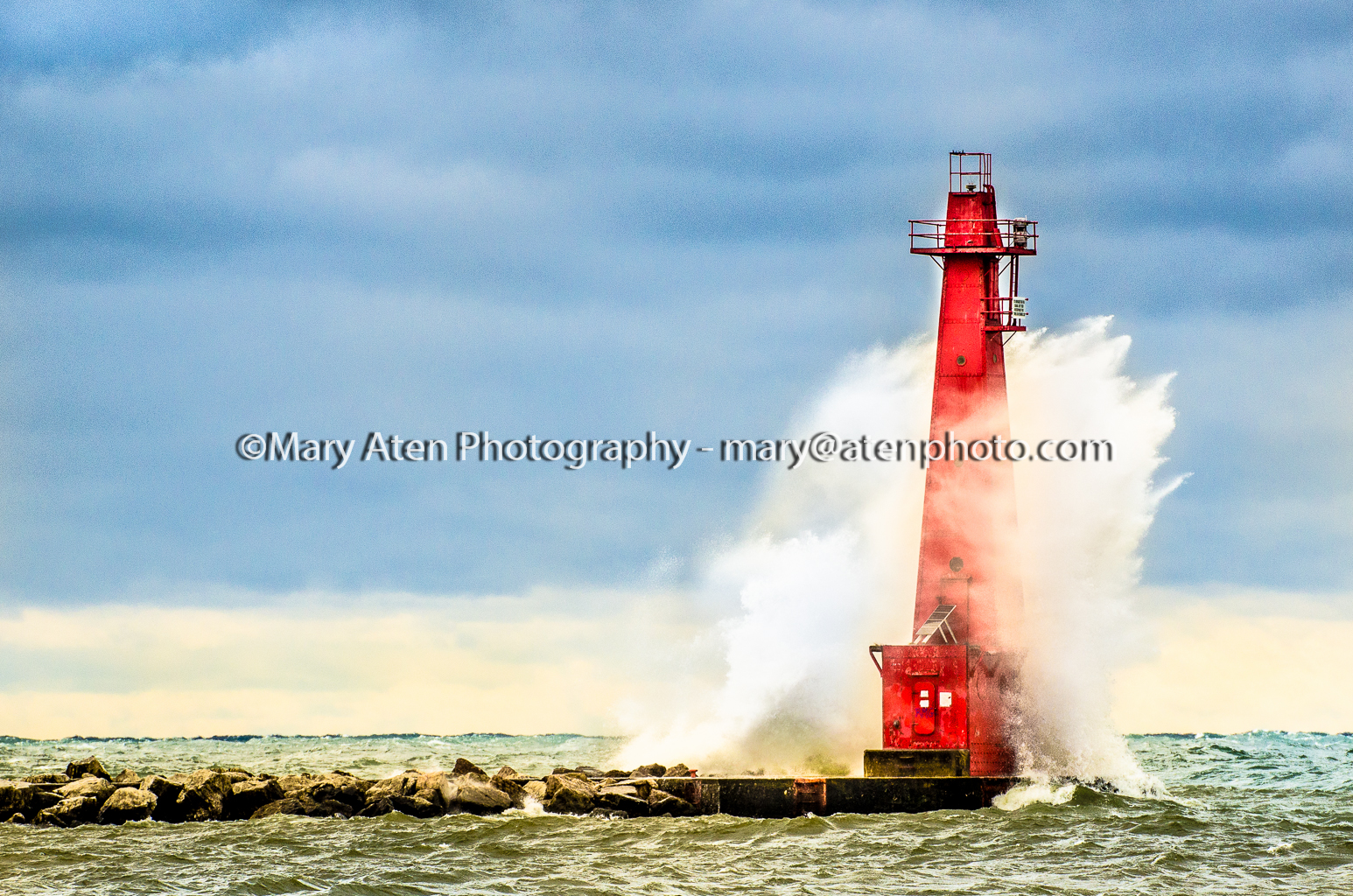 Photo Of Muskegon Lighthouse And Breakwall With Wave Spray